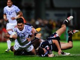 Joseph Leilua of Samoa is held up by the challenge of William Barthau during the Rugby League World Cup Group B match between France and Samoa on November 11, 2013