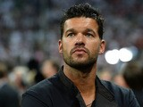 Former Germany player Michael Ballack looks on during the World Cup qualifying match between Austria and Germany on September 6, 2013