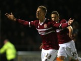Luke Norris of Northampton Town celebrates after scoring his sides goal during the Sky Bet League Two match between Northampton Town and Fleetwood Town at Sixfields Stadium on November 16, 2013