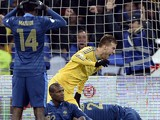 Ukraine's forward Andriy Yarmolenko celebrates next to France's defender Blaise Matuidi and defenders Eric Abidal and Laurent Koscielny after Ukraine scored a goal during the 2014 FIFA World Cup qualifying play-off first leg football match between Ukraine