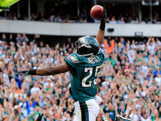 Running back LeSean McCoy of the Philadelphia Eagles dunks the ball over the goal post after scoring a first half touchdown against the Washington Redskins on November 17, 2013