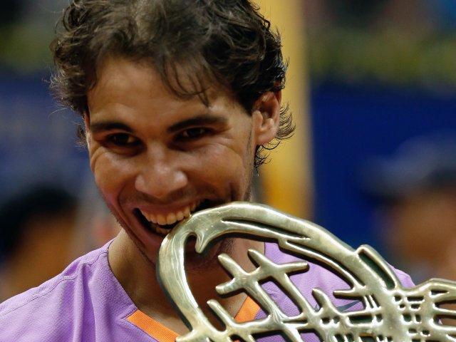 Rafael Nadal celebrates winning the Brazil Open on February 17, 2013.