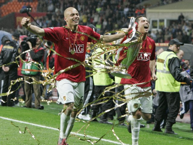 Wes Brown and Cristiano Ronaldo celebrate with the Champions League trophy on May 21, 2008.