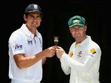 England captain Alastair Cook holds the Ashes urn with opposite number Michael Clarke of Australia ahead of the first Test match in Brisbane on November 20, 2013