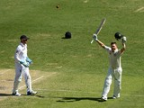 Michael Clarke of Australia celebrates after reaching his century during day three of the First Ashes Test match between Australia and England at The Gabba on November 23, 2013