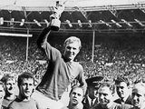 The England players lift Bobby Moore up with the World Cup trophy on July 30, 1966.