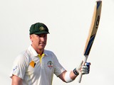 Australian batsman Brad Haddin celebrates his 50 runs innings during day one of the first Ashes cricket Test match between England and Australia at the Gabba Cricket Ground in Brisbane on November 21, 2013