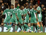 Bright Dike of Nigeria celebrates scoring the first goal during the international friendly match between Italy and Nigeria at Craven Cottage on November 18, 2013