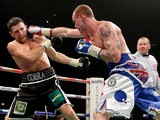 Carl Froch and George Groves in action during their IBF & WBA World Super Middleweight Title fight on November 23, 2013