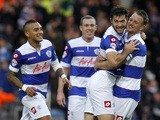 Charlie Austin of QPR celebrates with team mate Clint Hill after scoring the first goal of the game during the Sky Bet Championship match against Charlton on November 23, 2013