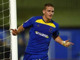 Charlie Strutton of AFC Wimbledon celebrates his second goal during the FA Cup First Round Replay between AFC Wimbledon and York City at The Cherry Red Records Stadium on November 12, 2012