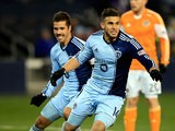 Sporting Kansas City's Dom Dwyer celebrates after scoring the winning goal against Houston on November 23, 2013