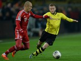 Bayern Munich's Dutch midfielder Arjen Robben and Dortmund's Polish midfielder Jakub Blaszczykowski vie for the ball during the German first division Bundesliga football match between Borussia Dortmund and Bayern Munich in Dortmund, western Germany, on No