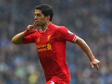 Luis Suarez of Liverpool celebrates scoring his team's second goal during the Barclays Premier League match between Everton and Liverpool at Goodison Park on November 23, 2013