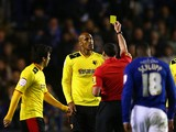 Fitz Hall of Watford receives a yellow card from referee Neil Swarbrick after a tackle on Andy King of Leicester City during the npower Championship Play Off Semi Final First Leg match between Leicester City and Watford at The King Power Stadium on May 9,