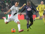 Rennes' Algerian midfielder Foued Kadir vies with Bordeaux's Cameroonese midfielder Landry Nguemo during the French L1 football match Rennes vs Bordeaux on November 23, 2013