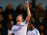 Frank Lampard of Chelsea celebrates scoring their first goal from the penalty spot during the Barclays Premier League match against West Ham United on November 23, 2013