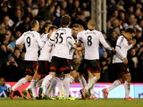Scott Parker of Fulham is congratulated by teammates after scoring a goal to level the scores at 1-1 during the Barclays Premier League match between Fulham and Swansea City at Craven Cottage on November 23, 2013