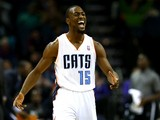 Kemba Walker #15 of the Charlotte Bobcats reacts after making a basket during their game against the Brooklyn Nets at Time Warner Cable Arena on November 20, 2013