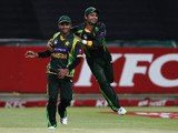 Pakistan captain Mohammad Hafeez and Ahmed Shehzad of Pakistan celebrate Pakistan beat South Africa to level the series 1-1 during the 2nd T20 International match between South Africa and Pakistan at Sahara Park Newlands on November 22, 2013