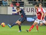 Paris Saint-Germain's Brazilian forward Lucas Moura strikes to score a goal during the French Football match Reims vs Paris Saint-Germain, on November 23, 2013