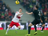 Poland's Robert Lewandowski and Ireland's John O'Shea battle for the ball during their international friendly match on November 19, 2013