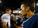 Tom Brady of the New England Patriots and Peyton Manning of the Denver Broncos greet each other at midfield following a game on October 7, 2012