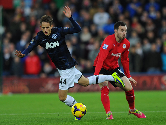 Man United's Adnan Januzaj and Cardiff Don Cowie battle for the ball during their Premier League match on November 24, 2013