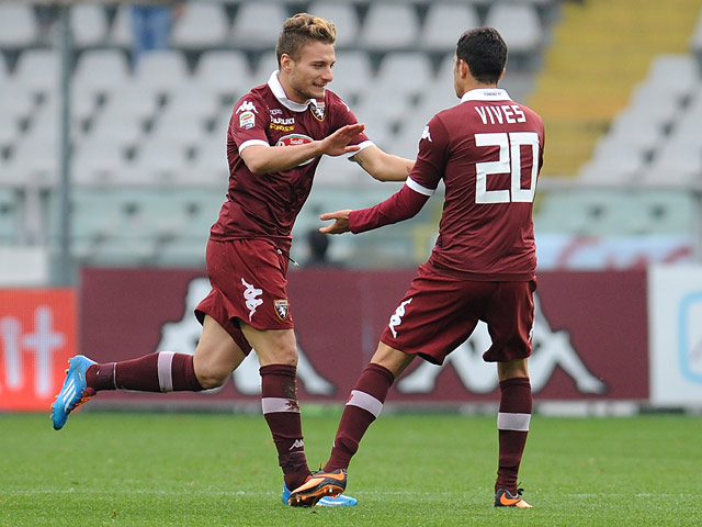 Torino's Ciro Immobile celebrates with teammate Giuseppe Vives after scoring the opening goal against Catania during their Serie A match on November 24, 2013