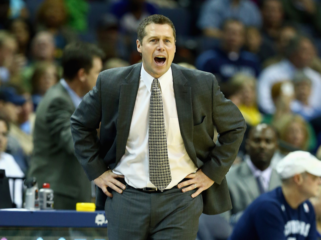 Dave Joerger the head coach of the Memphis Grizzlies gives instructions to his team during the NBA game against the Boston Celtics at FedExForum on November 4, 2013