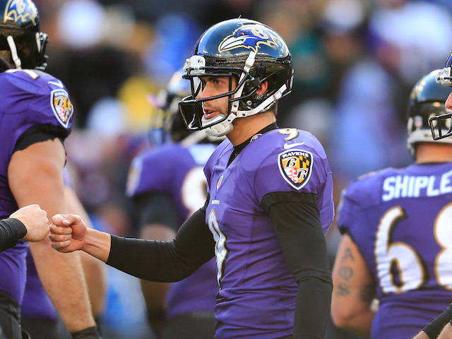Kicker Justin Tucker of the Baltimore Ravens celebrates after kicking his third field goal against the New York Jets during the second quarter at M&T Bank Stadium on November 24, 2013