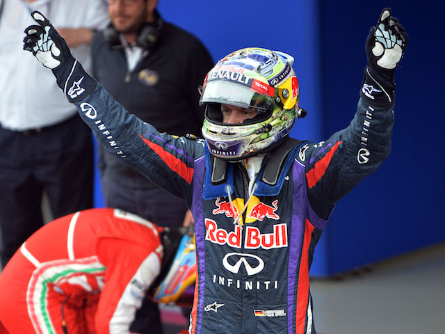 German Formula One driver Sebastian Vettel celebrates his victory in the Brazil F-1 GP on November 24, 2013