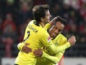 Dortmund's Gabonese striker Pierre-Emerick Aubameyang celebrates after scoring 1-0 during the German first division Bundesliga football match FSV Mainz 05 vs Borussia Dortmund in Mainz on November 30, 2013