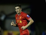 Adam Morgan of Liverpool U21 in action during the Barclays U21s Premier League match between Manchester City U21 and Liverpool U21 at Ewen Fields on September 23, 2013