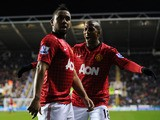 Anderson of Manchester United celebrates scoring a goal with teammate Ashley Young during the Barclays Premier League match between Reading