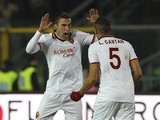 Kevin Strootman of AS Roma celebrates his goal with team-mate Leandro Castan during the Serie A match between Atalanta BC and AS Roma at Stadio Atleti Azzurri d'Italia on December 1, 2013