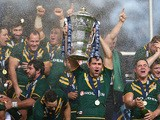 Cameron Smith the captain of Australia lifts the winners trophy after his sides 34-2 victory during the Rugby League World Cup Final between Australia and New Zealand on November 30, 2013