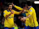 Mathieu Flamini of Arsenal celebrates with Olivier Giroud and Nacho Monreal  as he scores their second goal during the Barclays Premier League match between Cardiff City and Arsenal at Cardiff City Stadium on November 30, 2013
