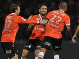Lorient's players celebrate after Lorient's French forward Kevin Monnet-Paquet scored during the French L1 football match Lorient against Nice on November 30, 2013