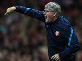 Arsenal assistant manager Pat Rice directs the team during the UEFA Champions League play-off first leg match between Arsenal and Udinese at the Emirates Stadium on August 16, 2011