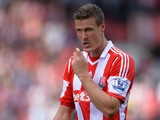 Robert Huth of Stoke City removes his mouthguard during the Barclays Premier League match between Stoke City and Crystal Palace at Britannia Stadium on August 24, 2013