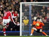 Arsenal's Dutch player Robin van Persie shoots past Chelsea's Czech goalkeeper Petr Cech to score during the Premiership match at Stamford Bridge in London on November 30, 2008