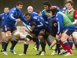 France's rugby union national team flanker and captain Thierry Dusautoir practices with teammates during a training session on November 26, 2013