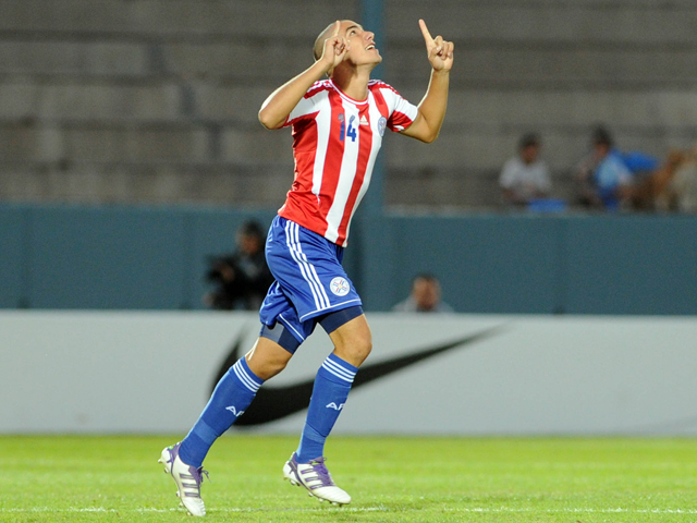 Paraguay's national U-17 football team player Antonio Sanabria celebrates after scoring against Argentina during their U-17 South American football tournament group A match in Ciudad de la Punta, province of San Luis, Argentina, on April 4, 2013