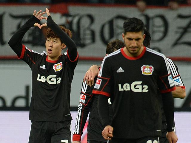 Leverkusen's South Korean striker Heung Min Son celebrates scoring with his teammates during the German first division Bundesliga football match Bayer Leverkusen vs 1 FC Nuernberg in Leverkusen on November 30, 2013