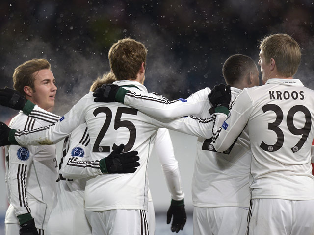 Bayern Munich players celebrates after scoring against CSKA Moscow during their Champions League group match on November 27, 2013
