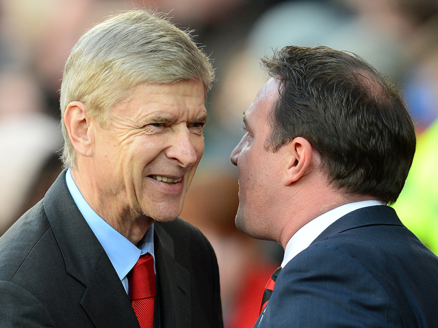 Arsenal's French manager Arsene Wenger chats with Cardiff City manager Malky Mackay before the English Premier League football match between Cardiff City and Arsenal at The Cardiff City stadium in Cardiff, south Wales on November 30, 2013