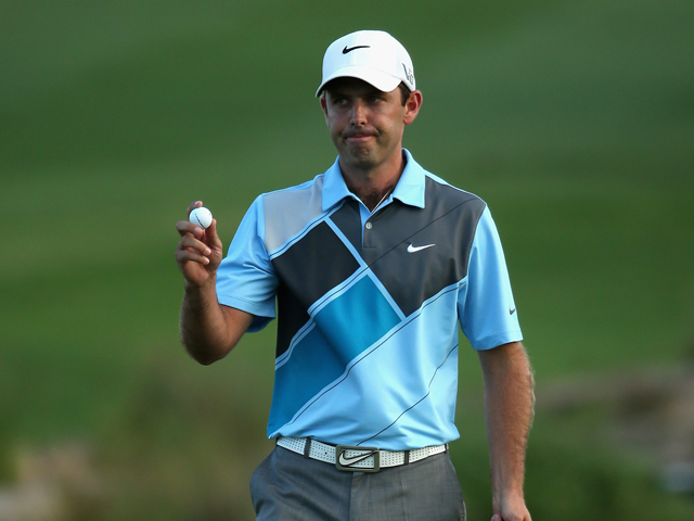 Charl Schwartzel of South Africa acknowledges the crowd on the 18th green during the second round of the Alfred Dunhill Championship at Leopard Creek Country Club on November 29, 2013