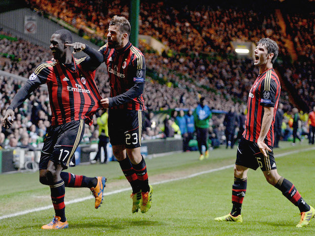 Cristian Zapata of AC Milan celebrates after scoring with Antonio Nocerino during the UEFA Champions League Group H match against Celtic on November 26, 2013