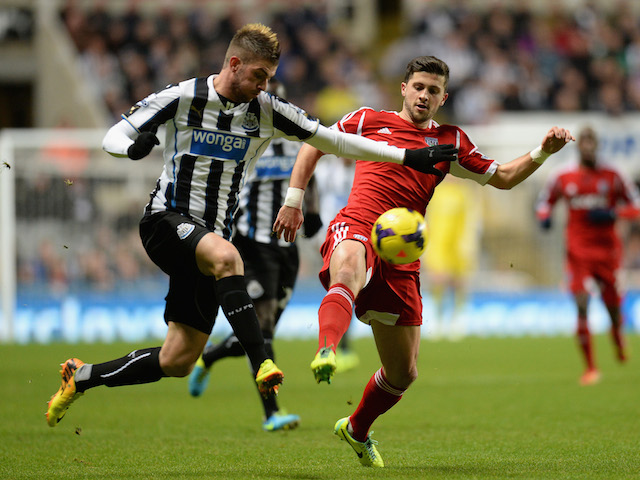 Davide Santon of Newcastle United competes with Shane Long of West Bromwich Albion during the Barclays Premier League match on November 30, 2013